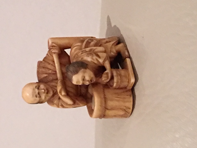 Netsuke ivory couple performing ablutions.JPG
