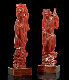 1265808_a_pair_of_pressed_amber_figures_of_immortals_19th_century_d5317854h.jpg